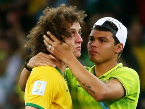 Thiago Silva of Brazil (R) consoles teammate David Luiz after Germany's 7-1 victory during the 2014 FIFA World Cup Brazil Semi Final match on July 8, 2014