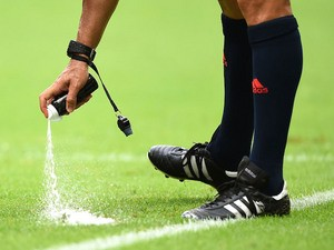 Referee Carlos Velasco Carballo sprays a temporary line during the 2014 FIFA World Cup Brazil Group F match between Bosnia and Herzegovina and Iran on June 25, 2014
