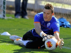 Valencia's goalkeeper Vicente Guaita stops a ball during a training session at Ciudad Deportiva Paterna, in Paterna on April 30, 2014