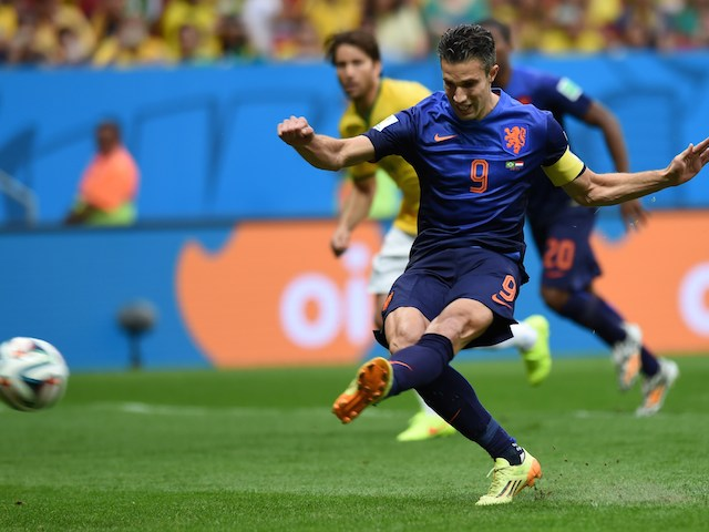 Netherlands' forward and captain Robin van Persie takes a penalty kick to score a goal during the third place play-off football match against Brazil on July 12, 2014