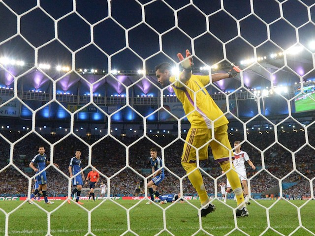 Argentina's goalkeeper Sergio Romero (C) watches a miss on goal during the 2014 FIFA World Cup final football match between Germany and Argentina on July 13, 2014