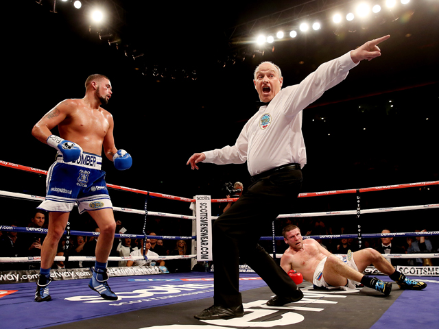 Tony Bellew of Great Britain knocks down Valery Brudov of Russia during their Vacant WBO International Cruiserweight bout at Liverpool Echo Arena on March 15, 2014