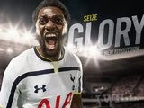 Emmanuel Adebayor models the Spurs 2014-15 home kit