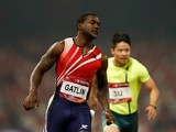 Justin Gatlin of the United States crosses the finishing line during 2014 IAAF Beijing Challenge at National Sports Center on May 21, 2014
