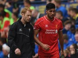 Emre Can of Liverpool is substituted with an injury during the pre season friendly match between Preston North End and Liverpool at Deepdale on July 19, 2014