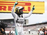 Nico Rosberg of Germany and Mercedes GP celebrates in Parc Ferme after victory in the German Grand Prix at Hockenheimring on July 20, 2014