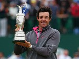 Northern Irishman Rory McIlroy holds the Claret Jug aloft after winning The Open at Royal Liverpool on July 20, 2014 in Hoylake, England