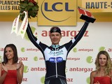Germany's Tony Martin celebrates his combativity prize on the podium at the end of the 161.50 km tenth stage of the 101st edition of the Tour de France cycling race on July 14, 2014