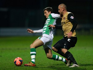 Adam Morgan of Yeovil Town is put under pressure by Scott Cuthbert of Leyton Orient during the FA Cup Third Round match between Yeovil Town and Leyton Orient at Huish Park on January 4, 2014