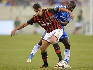 Chelsea's Ramires and AC Milan's Andrea Petagna vie for the ball during a 2013 International Champions Cup match at MetLife stadium in East Rutherford, New Jersey, on August 4, 2013