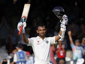 India's Ajinkya Rahane celebrates after reaching a century during play on the first day of the second cricket Test match between England and India at Lord's cricket ground in London on July 17, 2014
