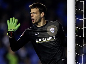 Luke Steele of Barnsley shouts instructions during the Sky Bet Championship match between Reading and Barnsley at Madejski Stadium on March 25, 2014