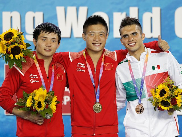 Medallists Qiu Bo, Yang Jian and Ivan Garcia after the men's 10m platform final at the FINA World Cup on July 20, 2014
