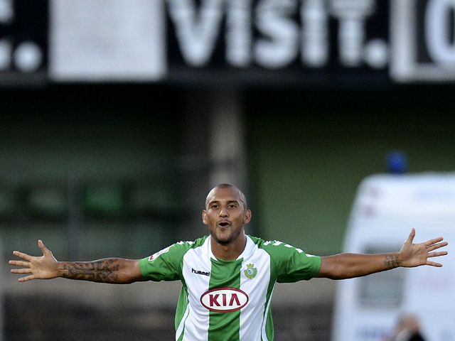 Setubal's forward Rafael Martins celebrates after scoring the opening goal during the Portuguese league football match Porto SC vs Vitoria Setubal at the Bonfim stadium in Setubal on August 18, 2013