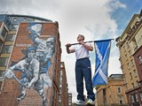 Euan Burton, multiple World and European medal winning judoka poses with the Scottish Saltire flag on September 21, 2014