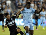 Sporting Kansas City midfielder Mikey Lopez battles with Manchester City FC forward Kelechi Iheanacho during an exhibition match at Sporting Park July 23, 2014