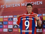 Bayern Munich's new Polish striker Robert Lewandowski holds his new trikot of the German first division Bundesliga team FC Bayern Munich during a news conference in Munich, southern Germany, on July 9, 2014