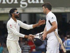 Indias Ravindra Jadeja shakes hands with Englands James Anderson after India win the match by 95 runs on the fifth day of the second cricket Test match between England and India at Lord's cricket ground in London on July 21, 2014