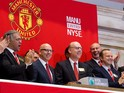 Manchester United Executives Joel Glazer and Avram Glazer and Ed Woodward prepare to ring the Opening Bell at the New York Stock Exchange on August 10, 2012
