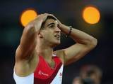 Adam Gemili holds his hands on his head after finishing second in the men's 100m on July 28, 2014
