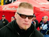 MMA fighter Brock Lesnar walks in the garage area during practice for the Daytona 500 at Daytona International Speedway on February 13, 2010