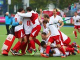 England players celebrate as they win bronze after a shoot out in the bronze medal match between New Zealand and England at Glasgow National Hockey Centre during day eleven of the Glasgow 2014 Commonwealth Games on August 3, 2014