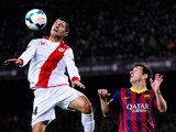 Lionel Messi of FC Barcelona duels for the ball with Iago Falque of Rayo Vallecano during the La Liga match between FC Barcelona and Rayo Vallecano de Madrid at Camp Nou on February 15, 2014