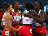 Shana Cox, Kelly Massey, Christine Ohuruogu and Anyika Onuora of England celebrate winning bronze in the Women's 4x400 metres relay final at Hampden Park during day ten of the Glasgow 2014 Commonwealth Games on August 2, 2014