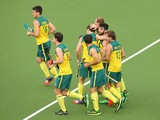 Trent Mitton of Australia celebrates with team mates after scoring during the Men's preliminaries match between South Africa and Australia at Glasgow National Hockey Centre during day five of the Glasgow 2014 Commonwealth Games on July 28, 2014