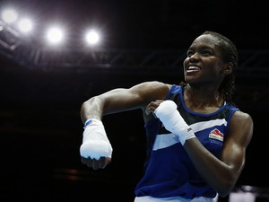 England's Nicola Adams reacts after winning the bout against Canada's Mandy Bujold during the Womens Fly semi-final boxing match at the 2014 Commonwealth Games in Glasgow, Scotland, on August 1, 2014