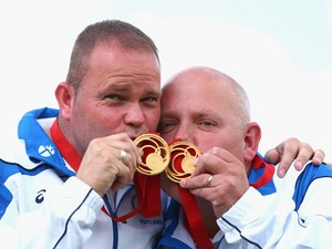 Paul Foster and Alex Marshall of Scotland celebrate with their gold medals after the Men's Pairs Final at Kelvingrove Lawn Bowls Centre during day five of the Glasgow 2014 Commonwealth Games on July 28, 2014