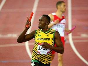 Usain Bolt of Jamaica celebrates winning gold in the Men's 4x100 metres relay final at Hampden Park during day ten of the G