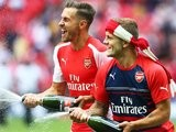 Arsenal's Aaron Ramsey and Jack Wilshere spray their teammates after winning the Community Shield on August 10, 2014