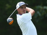 Rickie Fowler of the United States watches a shot during a practice round prior to the start of the 96th PGA Championship at Valhalla Golf Club on August 5, 2014