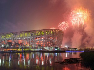 Fireworks explode over the National Stadium, also known as the 'Bird's Nest', during the opening ceremony of the 2008 Beijing Olympic Games on August 8, 2008