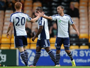 Kemar Roofe (R) of West Bromwich Albion celebrates with team-mate Liam O'Neil after he scores the first goal of the game for his side during the Pre Season Friendly against Port Vale on August 5, 2014