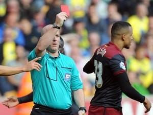 Norwich's Martin Olsson is shown the red card by Simon Hooper during the Canaries' Championship game with Wolves on August 10, 2014