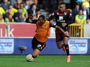 Rajiv Van La Parra of Wolves is brought down by Norwich's Martin Olsson on August 10, 2014