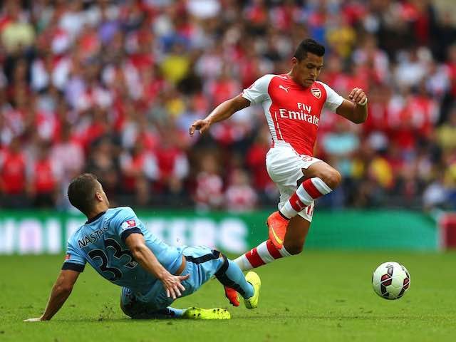 Arsenal's Alexis Sanchez leaps over Man City's Matija Nastasic during the Community Shield on August 10, 2014
