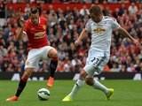 United's Adnan Janujaz is approached by Swansea midfielder Gylfi Sigurdsson on August 16, 2014