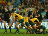 Rob Simmons of the Wallabies passes during The Rugby Championship match between the Australian Wallabies and the New Zealand All Blacks at ANZ Stadium on August 16, 2014