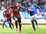 Clayton Donaldson of Birmingham City tangles with Aaron Hughes of Brighton & Hove Albion during the Sky Bet Championship match between Birmingham City and Brighton & Hove Albion at St Andrews (stadium) on August 16, 2014