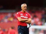 Keith Millen, caretaker manager of Crystal Palace looks on prior to the Barclays Premier League match between Arsenal and Crystal Palace at Emirates Stadium on August 16, 2014