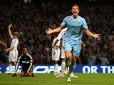 Edin Dzeko of Manchester City celebrates after scoring the opening goal during the Barclays Premier League match between Manchester City and Swansea City at Etihad Stadium on August 15, 2011