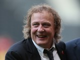 MK Dons chairman Pete Winkleman looks on prior to the Pre-Season Friendly match between MK Dons and Leicester City at Stadium mk on August 4, 2014