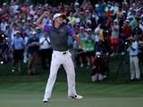 Rory McIlroy celebrates winning the PGA Championship on August 10, 2014