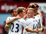 Eric Dier of Spurs is congratulated by teammates after scoring the match winning goal during the Barclays Premier League match between West Ham United and Tottenham Hotspur at Boleyn Ground on August 16, 2014