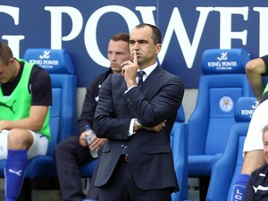 Everton's Spanish manager Roberto Martinez reacts to Leicester City's second equalising goal during the English Premier League football match between Leicester City and Everton at King Power Stadium in Leicester, central England on August 16, 2014