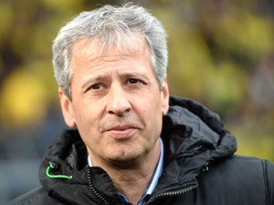 Monchengladbach's Swiss head coach Lucien Favre looks on prior to the German first division Bundesliga football match Borussia Dortmund vs Borussia Moenchengladbach in the German city of Dortmund on March 15, 2014