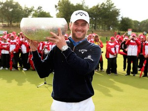 Marc Warren of Scotland poses with the trophy after winning Made In Denmark at Himmerland Golf & Spa Resort on August 17, 2014